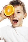 Little cute boy with orange fruit double isolated on white smili Royalty Free Stock Photos
