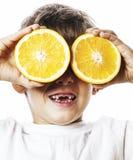 Little cute boy with orange fruit double isolated on white smili Royalty Free Stock Image