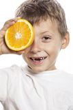 Little cute boy with orange fruit double isolated Royalty Free Stock Photography
