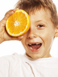 Little cute boy with orange fruit double isolated Stock Image