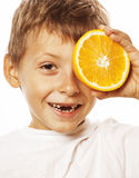 Little cute boy with orange fruit double isolated on white smiling without front teeth adorable kid cheerful Royalty Free Stock Image