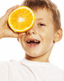 Little cute boy with orange fruit double isolated on white smiling without front teeth adorable kid cheerful Stock Photos