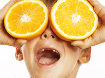 Little cute boy with orange fruit double  on white smiling without front teeth adorable kid cheerful Royalty Free Stock Photo