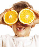 Little cute boy with orange fruit double  on white smiling without front teeth adorable kid cheerful Stock Photos