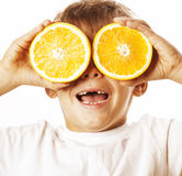 Little cute boy with orange fruit isolated on Stock Photography