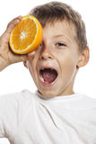 Little cute boy with orange fruit isolated on Royalty Free Stock Photography