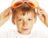 Little cute boy in orange sunglasses pointing  close up part of face Stock Image