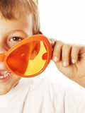 Little cute boy in orange sunglasses pointing Stock Images