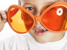 Little cute boy in orange sunglasses pointing Royalty Free Stock Photos