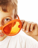 Little cute boy in orange sunglasses pointing isolated close up part of face Stock Images