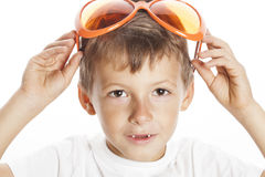 Little cute boy in orange sunglasses pointing isolated close up part of face Stock Photo