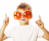 Little cute boy in orange sunglasses pointing Royalty Free Stock Images