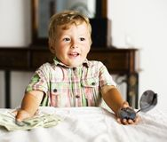 Little cute boy painting at home, lifestyle people concept Stock Images