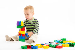 Little cute boy playing with building blocks. Isolated on white. Stock Photography
