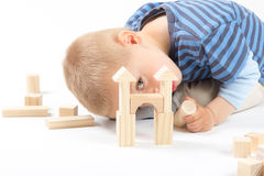 Little cute boy playing with building blocks. Isolated on white. Little cute boy playing with wooden building blocks. Isolated on white Royalty Free Stock Image