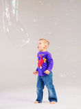 Little cute boy playing a soap bubbles Royalty Free Stock Image
