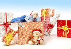 Little cute boy with plenty of gifts Royalty Free Stock Photo
