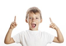 Little cute boy pointing in studio isolated close Royalty Free Stock Image