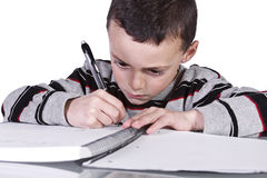 Little Cute Boy Practicing His Writing Skills Royalty Free Stock Image