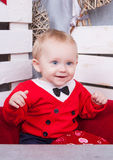 Little cute boy in red jacket with tie stock photography