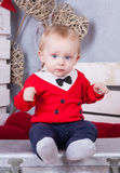 Little cute boy in red jacket with tie stock images