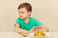 Little cute boy refuses to eat french fries Royalty Free Stock Photo