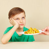 Little cute boy refuses to eat fried potatoes Stock Image