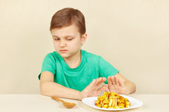 Little cute boy refuses to eat fries Stock Photography