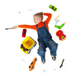 Little boy repairs toy car Royalty Free Stock Image