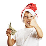 Little cute boy in santas red hat isolated with cash american do Royalty Free Stock Photo