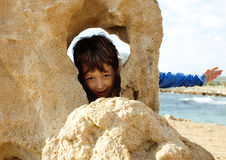 Little cute boy on sea coast Royalty Free Stock Images