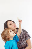 Little cute boy shows his hand up to his mother stock photos
