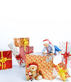Little cute boy sitting on the gift Stock Photo
