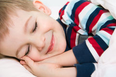 Little cute boy sleeping in bed Stock Image