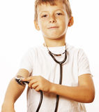 Little cute boy with stethoscope playing like adult profession doctor close up smiling isolated on white Royalty Free Stock Photo