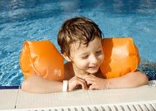 Little cute boy in swimming pool Stock Photo
