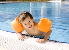 Little cute boy in swimming pool wearing Stock Photography