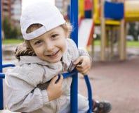 Little cute boy on swing outside Stock Images