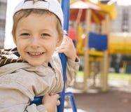 Little cute boy on swing outside Stock Photography