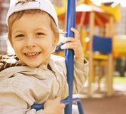 Little cute boy on swing outside, playground Royalty Free Stock Photography