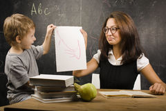 Little cute boy with teacher in classroom Stock Photo