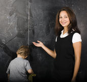 Little cute boy with teacher in classroom Stock Image