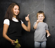 Little cute boy with teacher in classroom Royalty Free Stock Photography