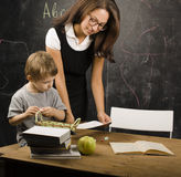 Little cute boy with teacher in classroom Stock Photo