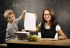 Little cute boy with teacher in classroom Royalty Free Stock Photos