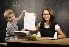 Little cute boy with teacher in classroom Royalty Free Stock Photos