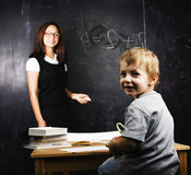 Little cute boy with teacher in classroom Stock Photography