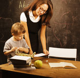 Little cute boy with teacher in classroom at Royalty Free Stock Photography
