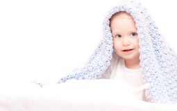 Little Cute Boy Under Blanket On The Bed Stock Photo