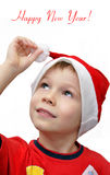 Little cute boy wears Santa's hat Stock Image